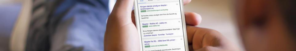 Iphone med skjermbilde som viser AdWords annonser