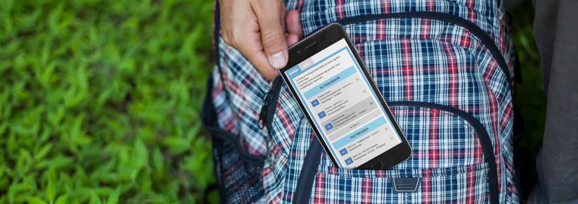 iphone med skjermbilde fra tromskortet.no