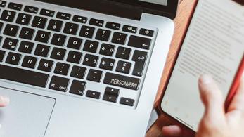 """Tastatur og telefon som sier """"Personvern"""""""