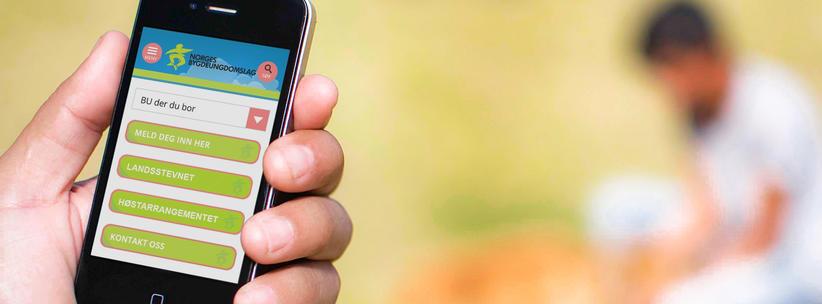 Hånd som holder mobil